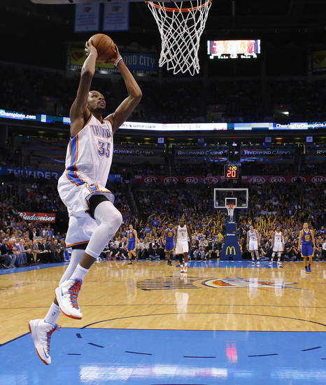 Oklahoma City's Kevin Durant (35) goes up for a dunk during an NBA basketball game between the Oklahoma City Thunder and the Golden State Warriors at Chesapeake Energy Arena in Oklahoma City, Wednesday, Feb. 6, 2013. Photo by Bryan Terry, The Oklahoman