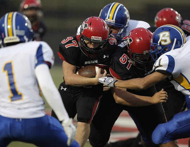 Mustang&#039;s Cutter Smith (37) runs the ball during a high school football game between Mustang and Stillwater in Mustang, Okla., Friday, Sept. 14, 2012.  Photo by Garett Fisbeck, The Oklahoman