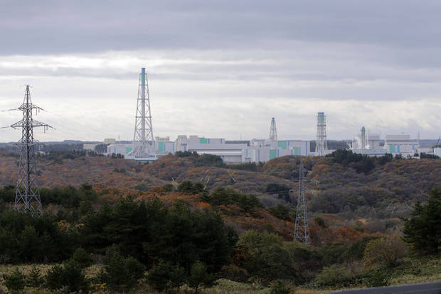 In this Nov. 8, 2012 photo, the Rokkasho spent nuclear fuel reprocessing plant facilities, run by Japan Nuclear Fuel Ltd., stand in Rokkasho village in Aomori Prefecture, northern Japan. By hosting a high-tech facility that would convert spent fuel into a plutonium-uranium mix designed for the next generation of reactors, Rokkasho was supposed to provide fuel while minimizing nuclear waste storage problems. Those ambitions are falling apart because years of attempts to build a �fast breeder� reactor, which would use the reprocessed fuel, appear to be ending in failure. (AP Photo/Koji Sasahara)