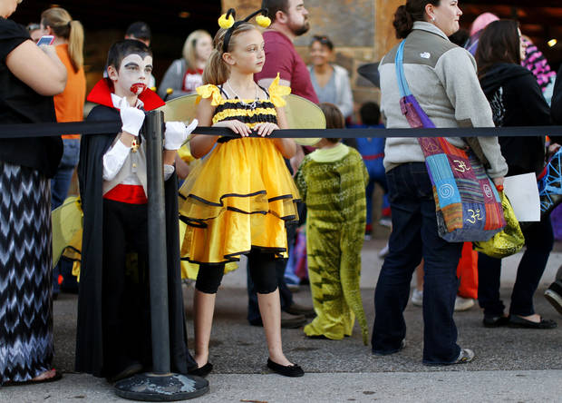 Danyale Green, 10, left, and Dillon Green, 8, of Edmond, stand in line for Haunt The Zoo at the Oklahoma CIty Zoo on Wednesday, October 31, 2012. Photo by Bryan Terry, The Oklahoman