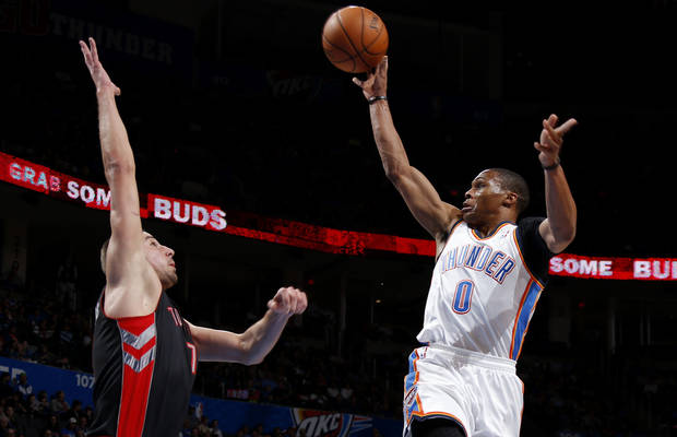 Oklahoma City's Russell Westbrook (0) puts up a shoot over Toronto's Jonas Valanciunas (17) during an NBA basketball game between the Oklahoma City Thunder and the Toronto Raptors at Chesapeake Energy Arena in Oklahoma City, Tuesday, Nov. 6, 2012.  Tuesday, Nov. 6, 2012. Oklahoma City won 108-88. Photo by Bryan Terry, The Oklahoman