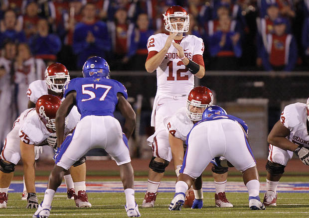 Oklahoma's Landry Jones (12) calls for a time out during the college football game between the University of Oklahoma Sooners (OU) and the University of Kansas Jayhawks (KU) on Saturday, Oct. 15, 2011. in Lawrence, Kan. Photo by Chris Landsberger, The Oklahoman