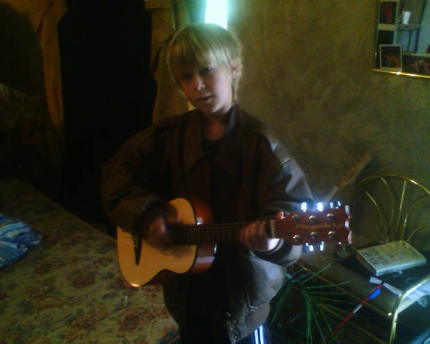 Kash Allen with guitar ..He's going to be a rock star..<br/><b>Community Photo By:</b> Tama , his mom<br/><b>Submitted By:</b> Tama, Midwest