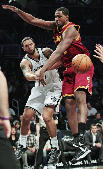 Brooklyn Nets' Deron Williams (8) passes away from Cleveland Cavaliers' Tristan Thompson during the first half of an NBA basketball game, Tuesday, Nov. 13, 2012, in New York. (AP Photo/Frank Franklin II)