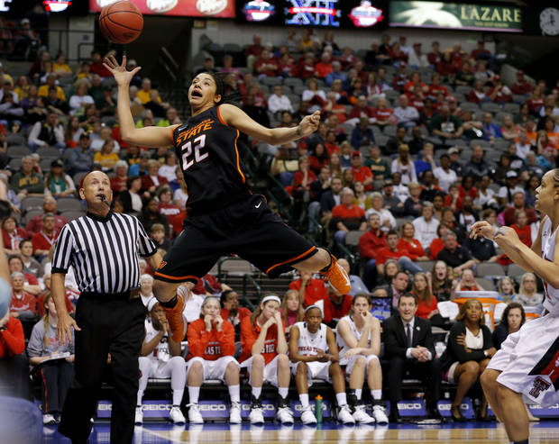Oklahoma State's Brittney Martin (22) tries to save the ball during the Big 12 tournament women's college basketball game between Oklahoma State University and Texas Tech University at American Airlines Arena in Dallas, Saturday, March 9, 2012. Photo by Bryan Terry, The Oklahoman