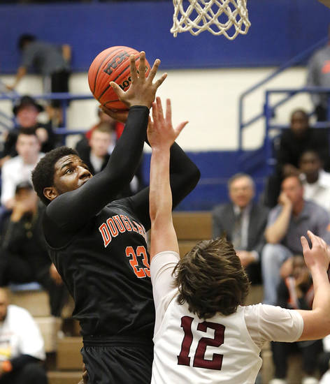 Douglass' Deondre Clark puts up a shot over the arm of Muldrow defender Colton Keith during first round games of Class 4A basketball state tournament in the Lyle Boren Activity Center at Choctaw High School on Thursday,  March 7, 2013.  Photo by Jim Beckel, The Oklahoman