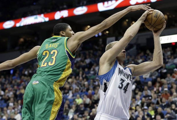 New Orleans Hornets' Anthony Davis, left, tries to block a shot by Minnesota Timberwolves' Greg Stiemsma in the second half of an NBA basketball game Saturday, Feb. 2, 2013 in Minneapolis. The Timberwolves won 115-86. Davis was called for a foul on the play. (AP Photo/Jim Mone)