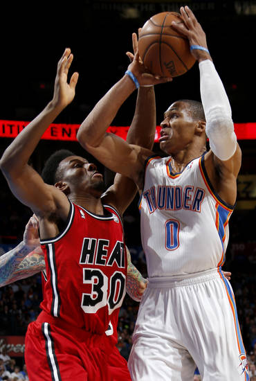 Oklahoma City's Russell Westbrook (0) tries to get past Miami's Norris Cole (30) during an NBA basketball game between the Oklahoma City Thunder and the Miami Heat at Chesapeake Energy Arena in Oklahoma City, Thursday, Feb. 15, 2013. Photo by Bryan Terry, The Oklahoman