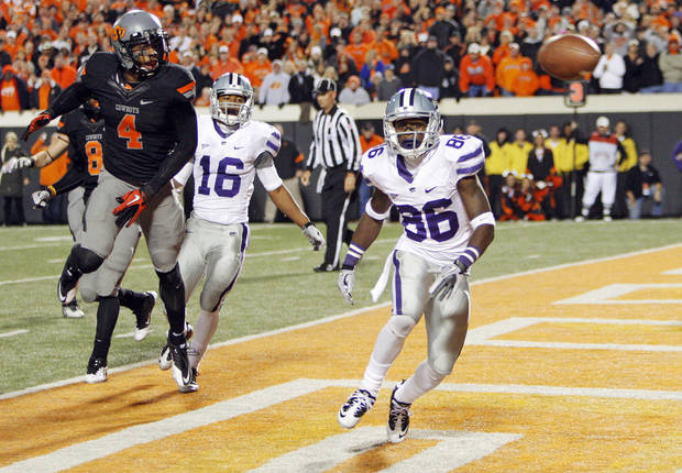 The ball falls incomplete for KSU on the last play of the game in front of Tramaine Thompson (86) and Tyler Lockett (16) of Kansas State along with Daytawion Loew (8) and Justin Gilbert (4) of OSU in the fourth quarter during a college football game between the Oklahoma State University Cowboys (OSU) and the Kansas State University Wildcats (KSU) at Boone Pickens Stadium in Stillwater, Okla., Saturday, Nov. 5, 2011. OSU won, 52-45. Photo by Nate Billings, The Oklahoman