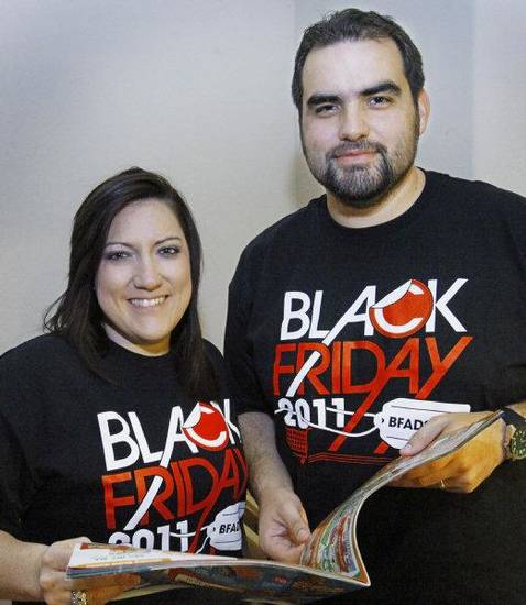Rachel and Travis Benham, of Mustang, have been preparing for shopping on Black Friday since October. <strong>DAVID MCDANIEL - THE OKLAHOMAN</strong>