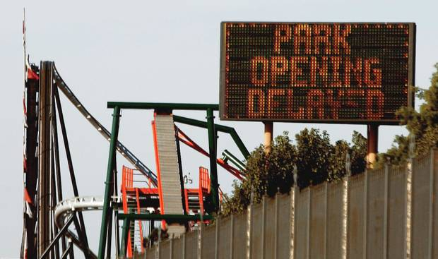 A sign outside Frontier City in Oklahoma City says opening was delayed Friday because E. coli was found in the water at the theme park.  Photo By Doug Hoke, THE OKLAHOMAN