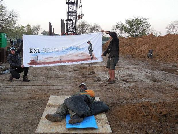 Protesters with the Great Plains Tar Sands Resistance try to block construction of the Keystone XL pipeline Thursday near Lula in Pontotoc County.  Photo provided