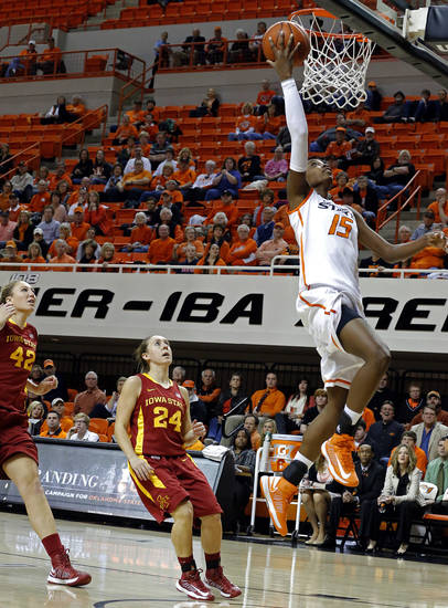 Oklahoma State's Toni Young (15) shoots a lay up in front of Iowa State's Amanda Zimmerman (42) and Elly Arganbright (24) during the women's college basketball game between Oklahoma State and Iowa State at  Gallagher-Iba Arena in Stillwater, Okla.,  Sunday,Jan. 20, 2013.  OSU won 71-42. Photo by Sarah Phipps, The Oklahoman