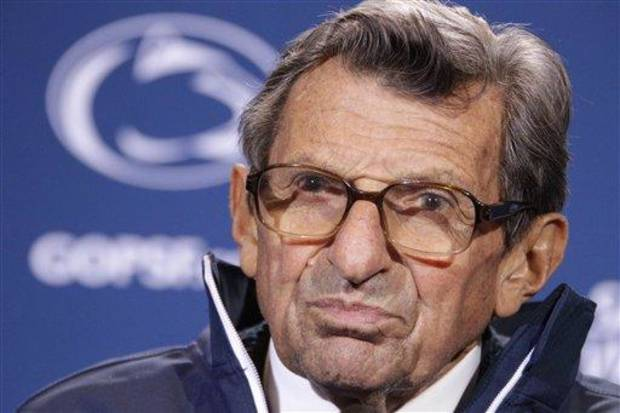 Penn State head coach Joe Paterno talks with reporters after recording his 409th career win 10-7 over Illinois in an NCAA college football game in State College, Pa., Saturday, Oct. 29, 2011.  (AP Photo/Gene J. Puskar)