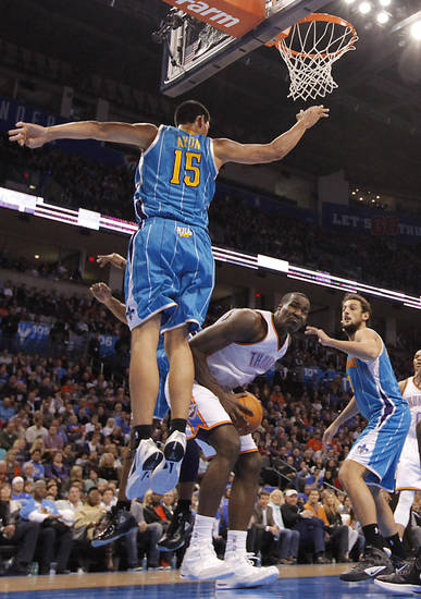 Oklahoma City Thunder center Kendrick Perkins (5) gets under New Orleans Hornets Gustavo Ayon (15)during the NBA basketball game between the Oklahoma City Thunder and the New Orleans Hornets at the Chesapeake Energy Arena on Wednesday, Jan. 25, 2012, in Oklahoma City, Okla. Photo by Chris Landsberger, The Oklahoman