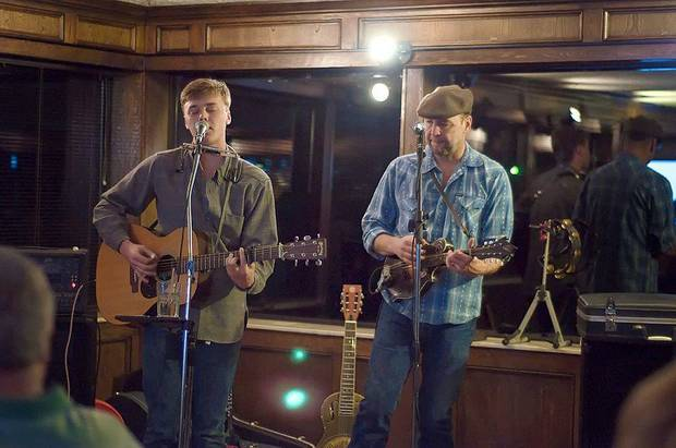 Parker Millsap, left, and John Cooper play during a recent show at Cushing Country Club. Cooper, a member of the Red Dirt Rangers, hosts the Third Thursday Concert Series at the country club. Photo by Stacey Lauren of C Sharp Studios - Cushing, OK <strong></strong>