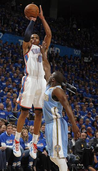 Oklahoma City&#039;s Russell Westbrook (0) shoots over Denver&#039;s Raymond Felton (20) during the first round NBA basketball playoff game between the Oklahoma City Thunder and the Denver Nuggets on Wednesday, April 20, 2011, at the Oklahoma City Arena. Photo by Sarah Phipps, The Oklahoman