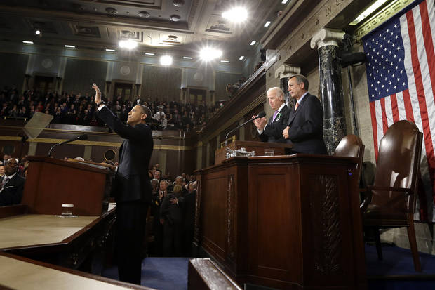 President Barack Obama waves before giving his State of the Union address during a joint session of Congress on Capitol Hill in Washington, Tuesday Feb. 12, 2013. Vice President Joe Biden and House Speaker John Boehner of Ohio stand behind the president. (AP Photo/Charles Dharapak, Pool) ORG XMIT: CAP513