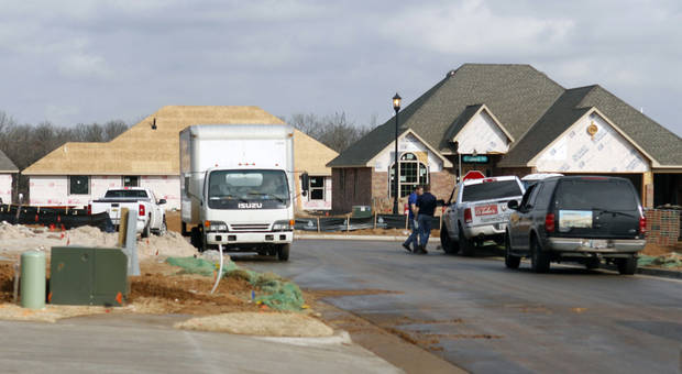 New single-family housing construction permits in Edmond are on the rise. Two streets of new homes are being built in Hampden Hallow, northeast of Covell Road and Air Depot Boulevard. PHOTO BY PAUL HELLSTERN, THE OKLAHOMAN. <strong>PAUL HELLSTERN - THE OKLAHOMAN</strong>