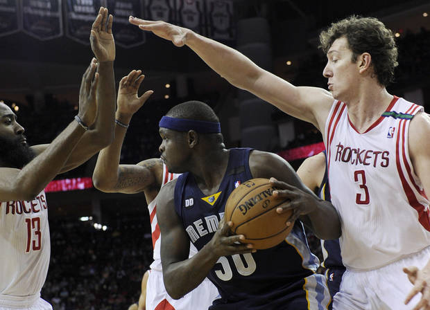 Memphis Grizzlies' Zach Randolph (50) is surrounded by Houston Rockets' James Harden and Omer Asik (3) in the first half of an NBA basketball game on Saturday, Dec. 22, 2012, in Houston. (AP Photo/Pat Sullivan)