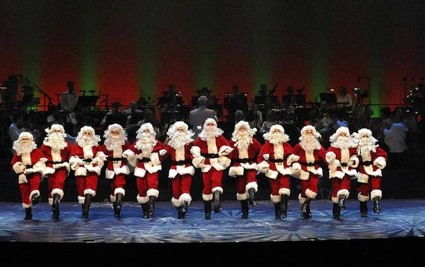 A line of Santas dance in the Oklahoma City Philharmonic&acirc;s &acirc;The Christmas Show.&acirc; Photo by Wendy Mutz