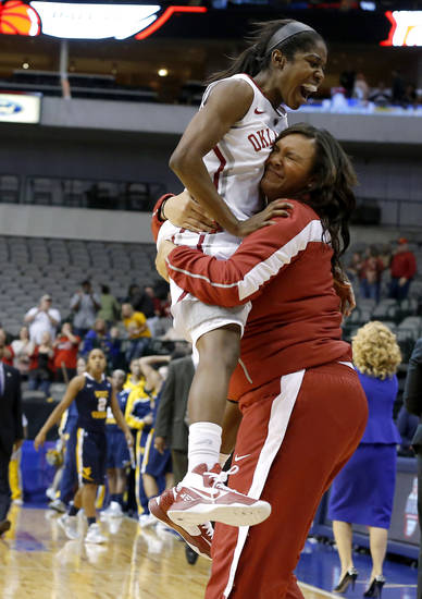 Oklahoma&#039;s Aaryn Ellenberg, left, celebrates with Lyndsey Cloman after Big 12 tournament women&#039;s college basketball game between the University of Oklahoma and West Virginia at American Airlines Arena in Dallas, Saturday, March 9, 2012. Oklahoma won 65-64.  Photo by Bryan Terry, The Oklahoman