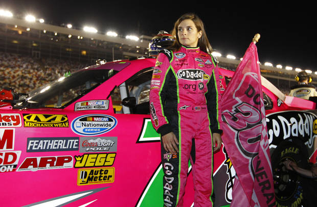 Danica Patrick waits for the start of the NASCAR Dollar General 300 Nationwide Series auto race in Concord, N.C., Friday, Oct. 12, 2012. (AP Photo/Chuck Burton)