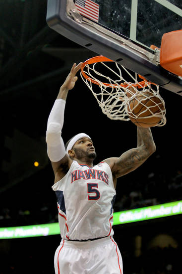 Atlanta Hawks small forward Josh Smith (5) dunks in the first half of an NBA basketball game against the Charlotte Bobcats, Thursday, Dec. 13, 2012, in Atlanta. (AP Photo/Todd Kirkland)