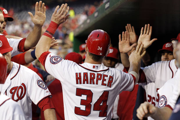 Washington Nationals' Bryce Harper (34) celebrates with teammates after scoring during the first inning of a baseball game with the Chicago Cubs at Nationals Park, Thursday, Sept. 6, 2012, in Washington. (AP Photo/Alex Brandon) <strong>Alex Brandon</strong>