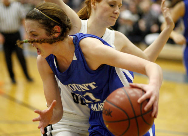 Mount St. Mary's Kaely Bond drives past   Nina Axtell of Perkins-Tryon during a Class 4A girls basketball state tournament game in Choctaw, Okla., Thursday, March 8, 2012. Photo by Bryan Terry, The Oklahoman