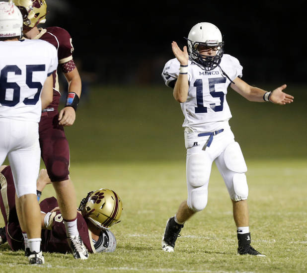 Minco's Ringo Garrett celebrates after sacking Cashion's Matt Harman during their high school football game in Cashion, Okla., Friday, Sept. 27, 2013. Photo by Bryan Terry, The Oklahoman