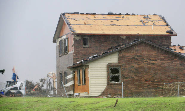 A house was damaged on the north side of State Highway 3 that was on the edge of a tornado moving north toward Piedmont.  Photo by Paul B. Southerland, The Oklahoman