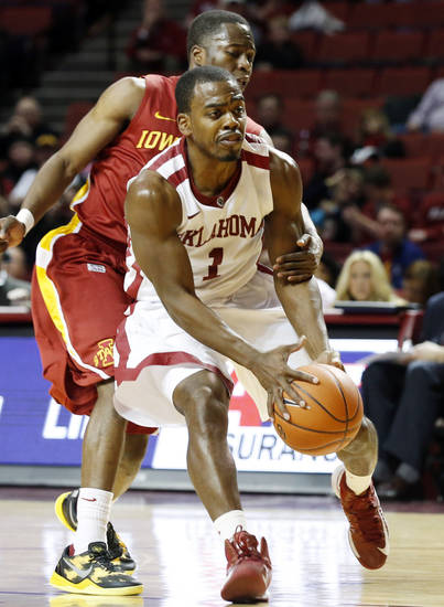 Iowa State's Bubu Palo (1) reaches around Oklahoma Sooner's Sam Grooms (1) as the University of Oklahoma Sooners (OU) men play the Iowa State Cyclones in NCAA, college basketball at Lloyd Noble Center on Saturday, March 2, 2013  in Norman, Okla. Photo by Steve Sisney, The Oklahoman