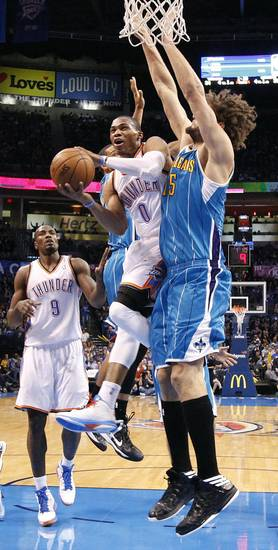Oklahoma City Thunder&#039;s Russell Westbrook (0) drives past New Orleans Hornets&#039; Robin Lopez (15) during the NBA basketball game between the Oklahoma CIty Thunder and the New Orleans Hornets at the Chesapeake Energy Arena on Wednesday, Dec. 12, 2012, in Oklahoma City, Okla.   Photo by Chris Landsberger, The Oklahoman