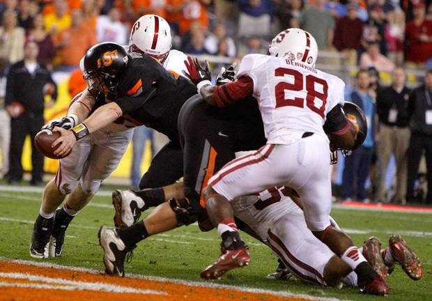 Oklahoma State's Brandon Weeden (3) scores a touchdown during the Fiesta Bowl between the Oklahoma State University Cowboys (OSU) and the Stanford Cardinals at the University of Phoenix Stadium in Glendale, Ariz., Monday, Jan. 2, 2012. Photo by Bryan Terry, The Oklahoman