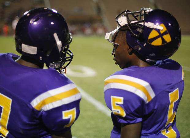 Jimmy Reece (5) talks with another player at the Northwest Classen vs. Western Heights high school football game at Taft Stadium Thursday, September 20, 2012. Photo by Doug Hoke, The Oklahoman