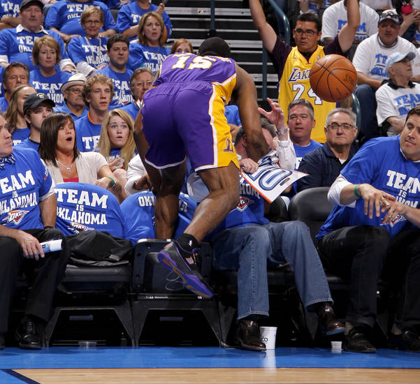 Los Angeles' Metta World Peace (15) falls into fans during Game 2 in the second round of the NBA playoffs between the Oklahoma City Thunder and L.A. Lakers at Chesapeake Energy Arena in Oklahoma City, Wednesday, May 16, 2012.  Oklahoma City won 77-75. Photo by Bryan Terry, The Oklahoman