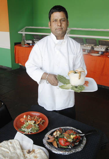 Chef Dominic Gomes shows some of the dishes he prepares at Heritage India, a new Indian restaurant in Edmond. <strong>PAUL HELLSTERN - Oklahoman</strong>