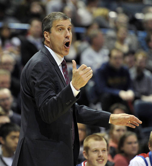 Washington Wizards head coach Randy Wittman yells out to his team as they play the Milwaukee Bucks during the first half of an NBA basketball game Monday, Feb. 11, 2013, in Milwaukee. (AP Photo/Jim Prisching)