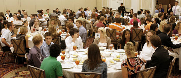 Interns talk with employers during a 2007 luncheon for the Greater Oklahoma City Chamber�s Greater Grads program. The Chamber launched the program a year earlier. PHOTO BY PAUL B. SOUTHERLAND, THE OKLAHOMAN ARCHIVEs