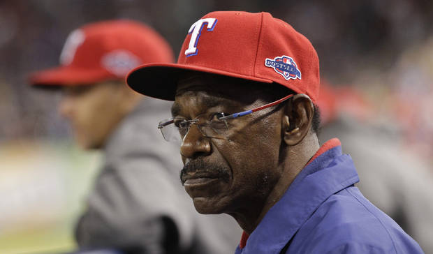 Texas Rangers manager Ron Washington (38) watches from the dugout in the eighth inning against the Baltimore Orioles in the American League wild-card playoff baseball game Friday, Oct. 5, 2012 in Arlington, Texas. (AP Photo/Tony Gutierrez)