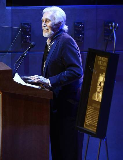 "Country music star Kenny Rogers gives his acceptance speech at the ceremony for the 2013 inductions into the Country Music Hall of Fame on Sunday, Oct. 27, 2013, in Nashville, Tenn. The inductees are Bobby Bare, the late ""Cowboy"" Jack Clement and Kenny Rogers. (AP)"