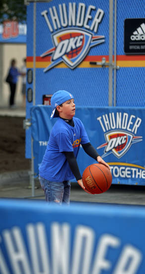 Alex Fields, 11, of Crescent, Okla., plays basketball before game five of the Western Conference semifinals between the Memphis Grizzlies and the Oklahoma City Thunder in the NBA basketball playoffs at Oklahoma City Arena in Oklahoma City, Wednesday, May 11, 2011. Photo by Bryan Terry, The Oklahoman