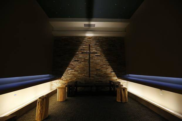 A cross glows on the stone wall of the reflection room inside the OK Kids Korral. Photo by Steve Gooch, The Oklahoman