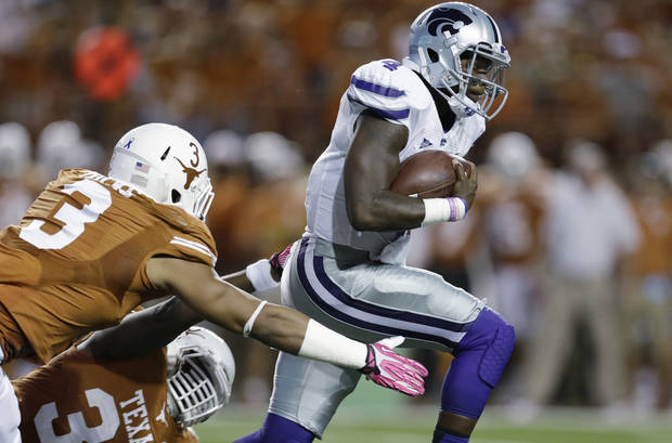 Kansas State's Daniel Sams (4) pulls away from Texas defenders Jordan Hicks (3) and Steve Edmond (33) during the first quarter of an NCAA college football game Saturday,  Sept. 21, 2013, in Austin, Texas. (AP Photo/Eric Gay) ORG XMIT: TXEG105