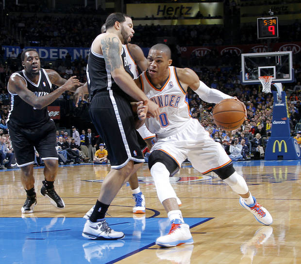 Oklahoma City's Russell Westbrook (0) drives against Brooklyn Nets' Deron Williams (8) during the NBA basketball game between the Oklahoma City Thunder and the Brooklyn Nets at the Chesapeake Energy Arena on Wednesday, Jan. 2, 2013, in Oklahoma City, Okla. Photo by Chris Landsberger, The Oklahoman