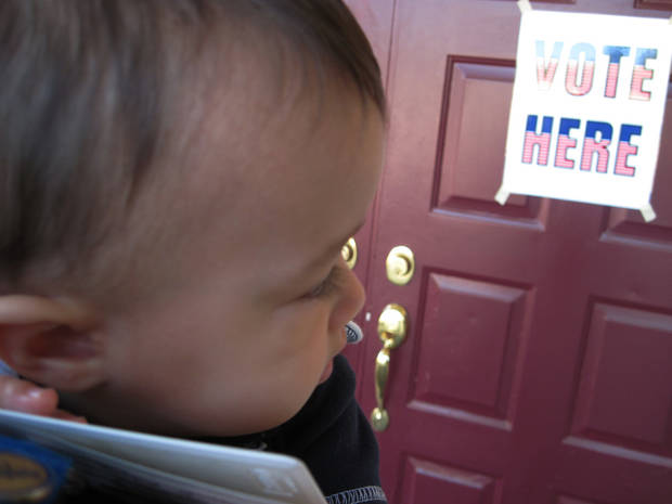 My daughter looks back at the door to our family polling place in sadness.