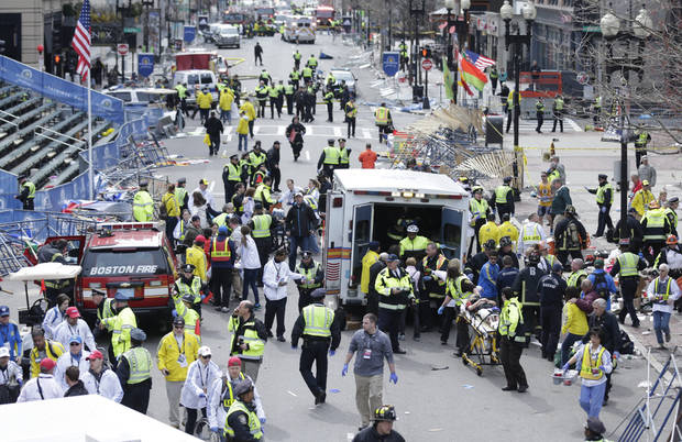 Medical workers aid injured people at the finish line of the 2013 Boston Marathon following an explosion in Boston, Monday, April 15, 2013. (AP Photo/Charles Krupa) ORG XMIT: MACK120