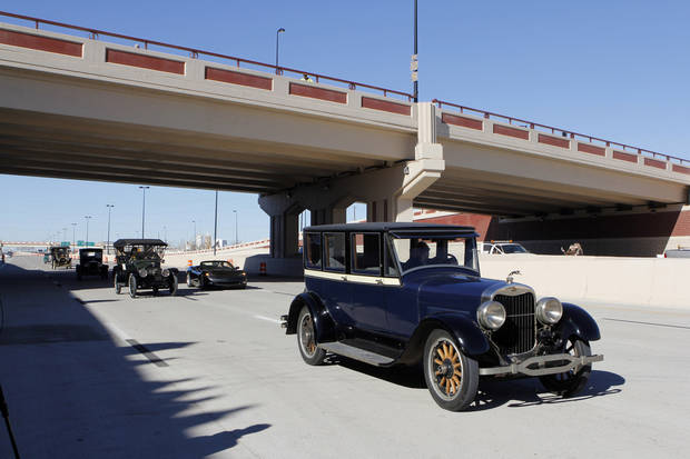 Antique cars cross under the Western Avenue Bridge during opening ceremony for the eastbound lanes of the Interstate 40 Crosstown. Photo by Paul B. Southerland, The Oklahoman archives