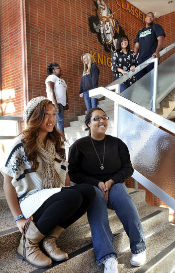 Northwest Classen High School students are shown on campus Wednesday. Seated in foreground are Huyen Nguyen, left, and Mackenzie Renfrow. Next level are Chaquion Joyner and Bethani Snow. Leaning against railing are Alexis Southammavong and Terrance Lowery. Photo by Jim Beckel, The Oklahoman